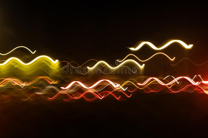 Abstract blurred colorful light effect on a black background. Long exposure photo of moving camera.  royalty free stock image