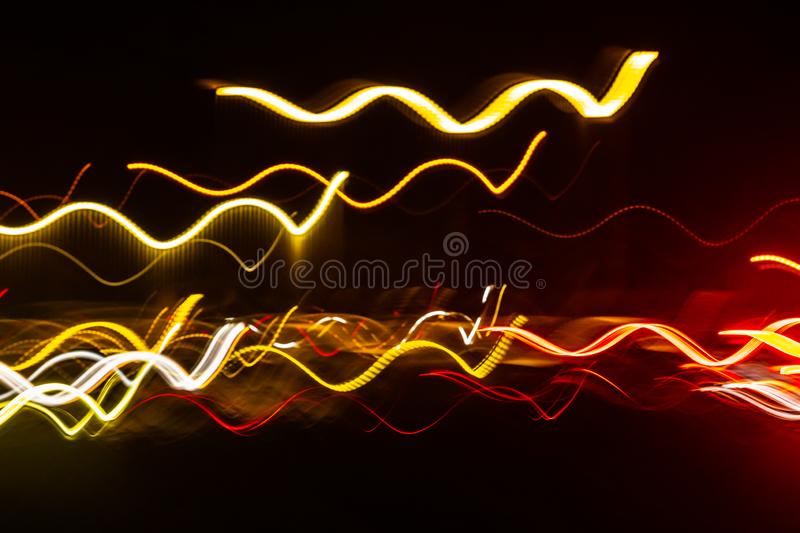 Abstract blurred colorful light effect on a black background. Long exposure photo of moving camera.  stock photo