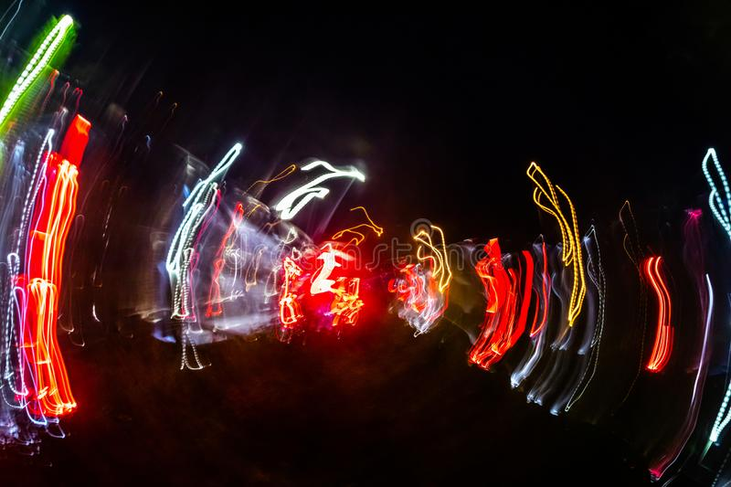 Abstract blurred colorful light effect on a black background. Long exposure photo of moving camera.  stock images