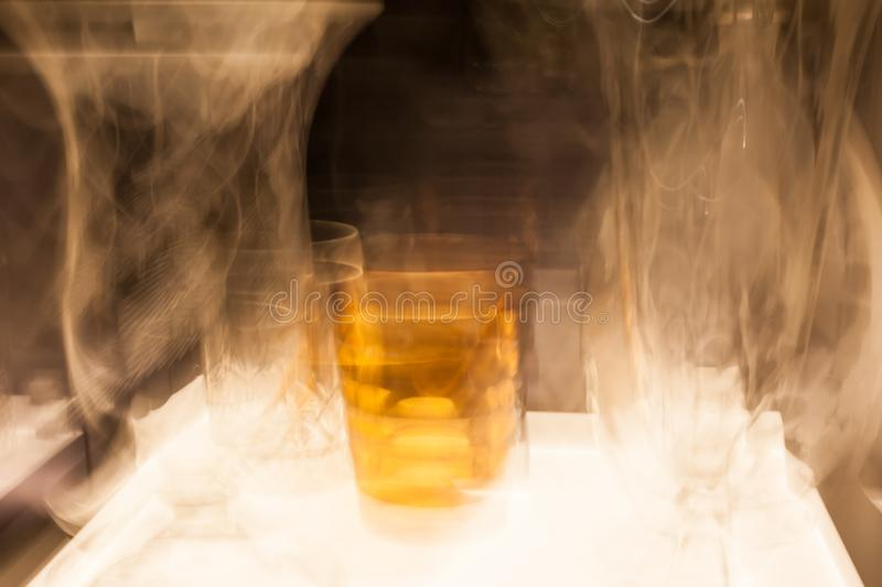 Abstract blurred colorful light effect on a glass. Long exposure photo of moving camera.  royalty free stock photo