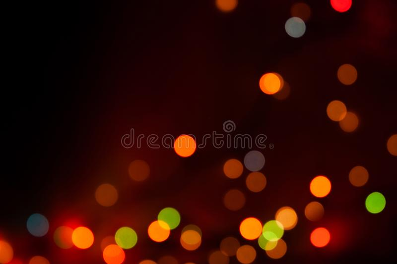 Abstract blurred dark background with beautiful bokeh effect. Abstract blurred dark multicolored background with beautiful bokeh effect royalty free stock photography