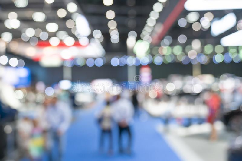 Abstract blurred defocused trade event exhibition background stock photo