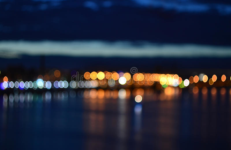 Abstract blurred evening defocused city lights. Background stock image