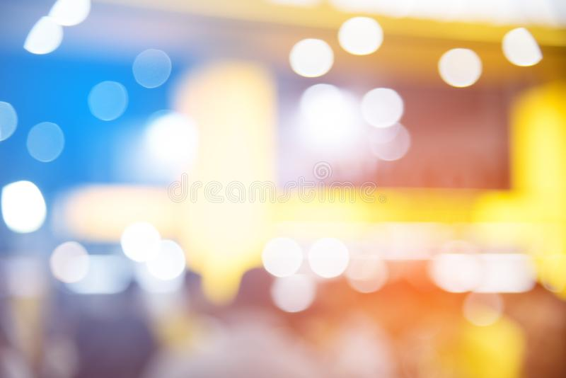 Abstract blurred of festival event with people and motor show ba. Ckground. Convention and Business event concept. People and lifestyle theme. Orange and Blue royalty free stock photos