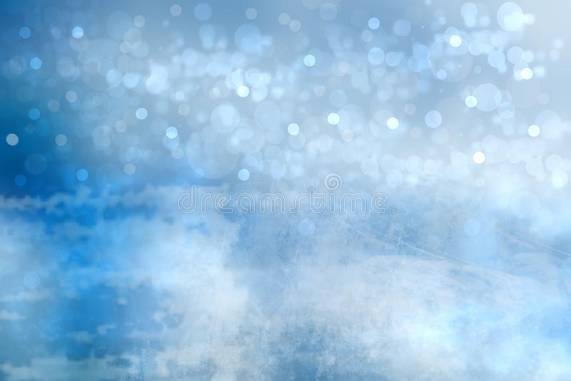 Abstract blurred festive winter christmas or Happy New Year background with shiny blue and white bokeh lighted snow landscape. royalty free stock image