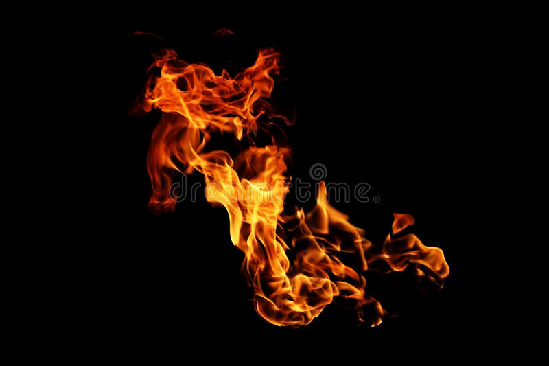 Abstract blurred fire flames isolated on black. Background royalty free stock photo