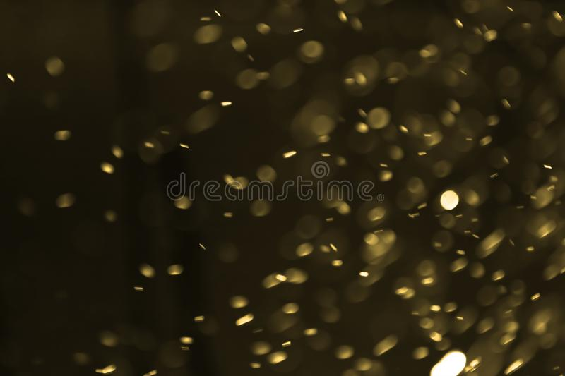 Abstract blurred gold bokeh lights background. Defocused glitter light royalty free stock photography