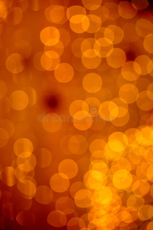 Abstract blurred golden glittering shine bulbs lights background. Christmas decorations concept with xmas holiday festival stock image