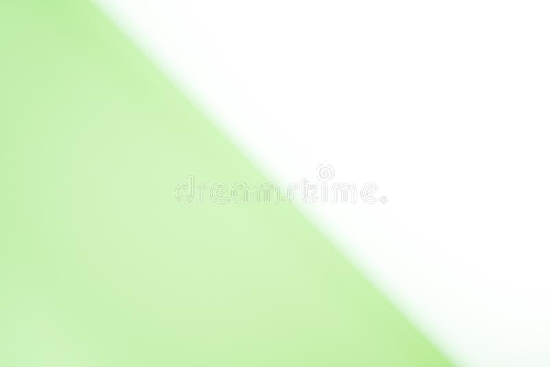 Abstract blurred gradient mesh background in bright white and lime green colors. Smooth template background royalty free stock photo
