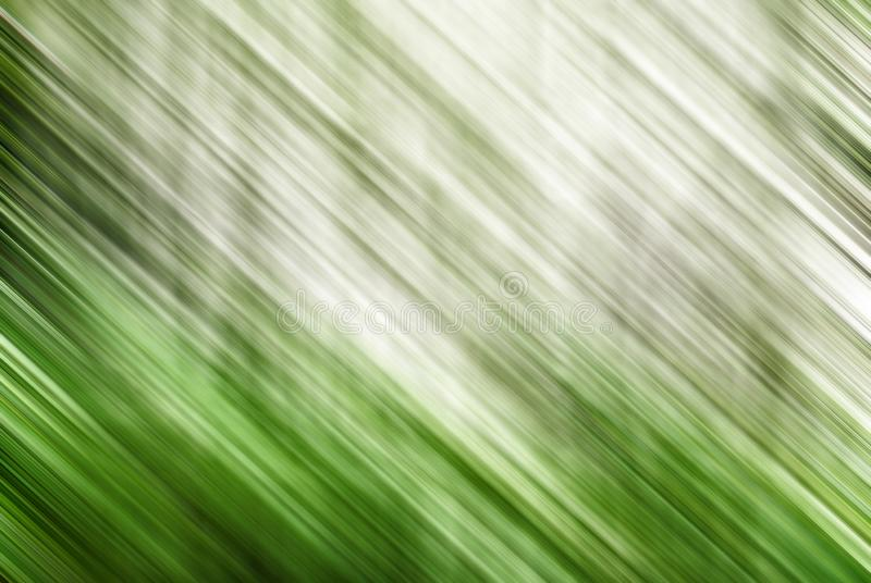 Abstract blurred gray and green background in motion royalty free stock photos