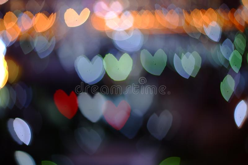 Abstract blurred heart bokeh lights backgrounds, Colorful bokeh of city night light royalty free stock photos