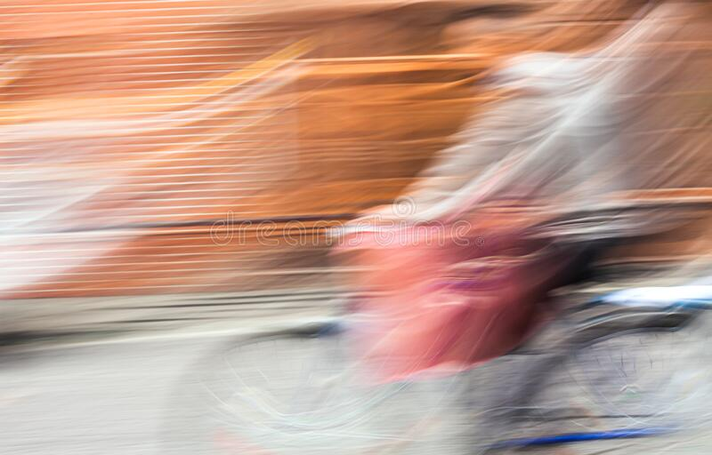 Abstract blurred image of cyclist royalty free stock images