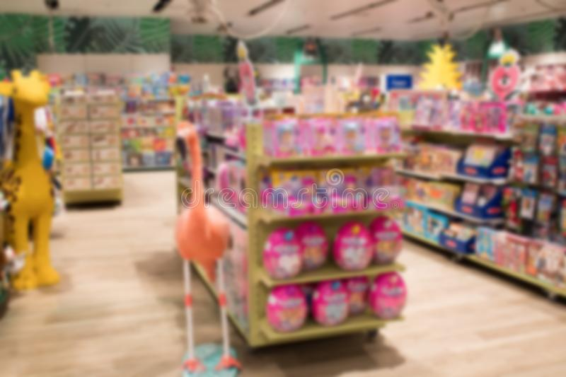 Abstract blurred image of shopping mall or retail store with product shelves. shopping center showcase. toy store royalty free stock photography
