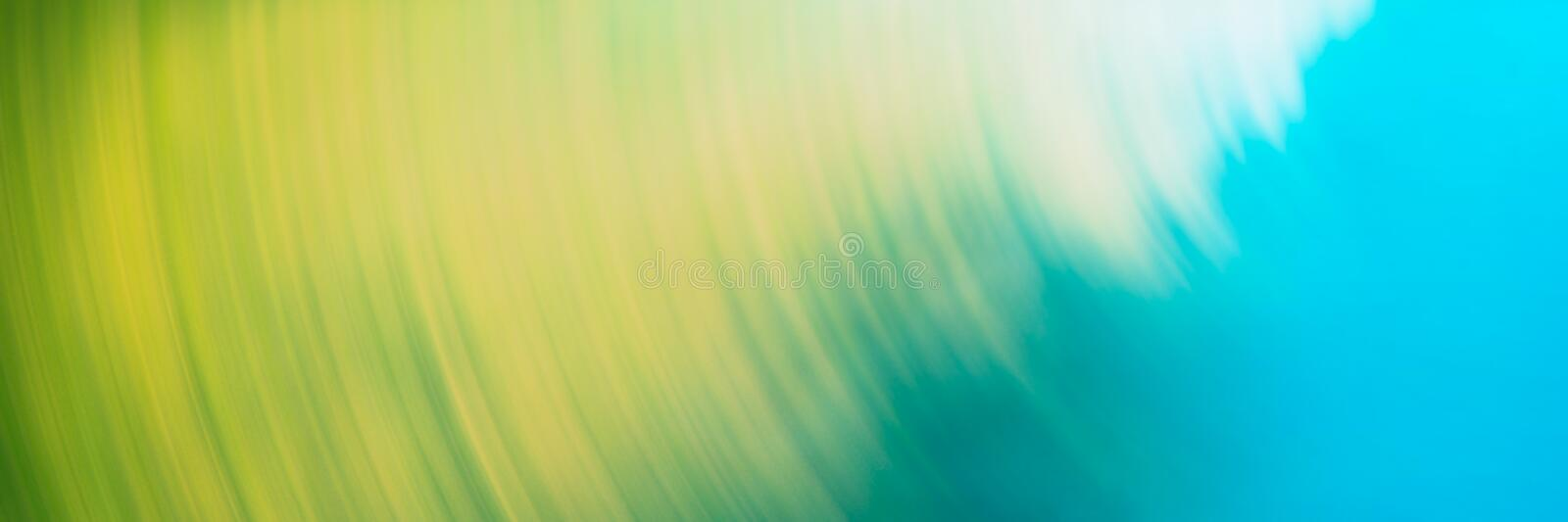 Abstract blurred light background, yellow, blue circular lines. Web banner for your design stock image