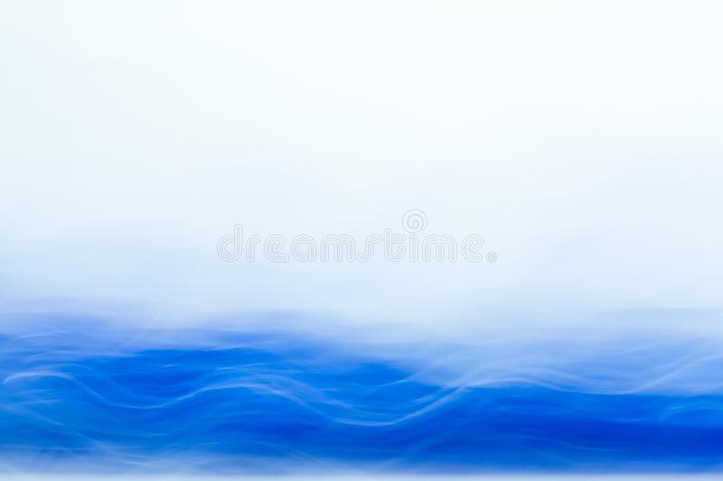 Abstract blurred light effect of blue wave on a white background. Long exposure photo of moving camera.  stock photos
