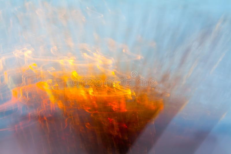 Abstract blurred light effect of orange waves on a blue background. Long exposure photo of moving camera.  royalty free stock photos