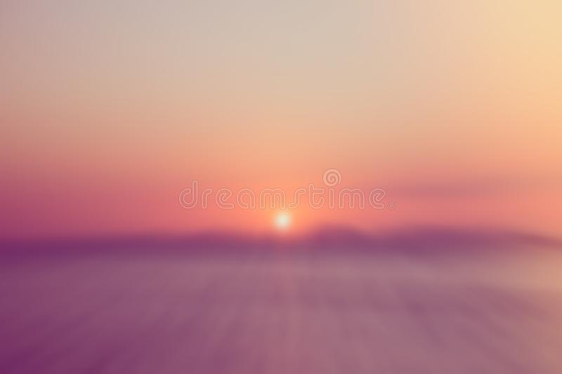 Abstract blurred light pink background, sunset at sea and mountains stock photos