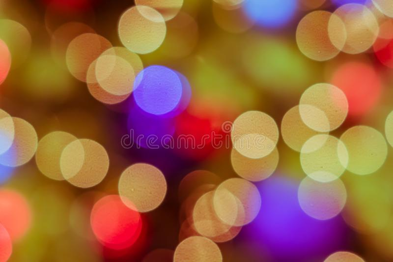 Abstract blurred lights on background in gold, purple, orange co stock image