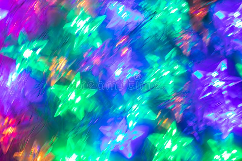Abstract blurred luminous background of bright star-shaped neon lights. royalty free stock photos