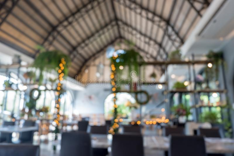 Abstract blurred luxury restaurant interior for background stock photography