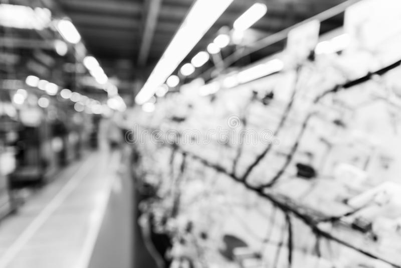 Abstract blurred manufacturing area at factory, background for industry, monochrome effect royalty free stock photography