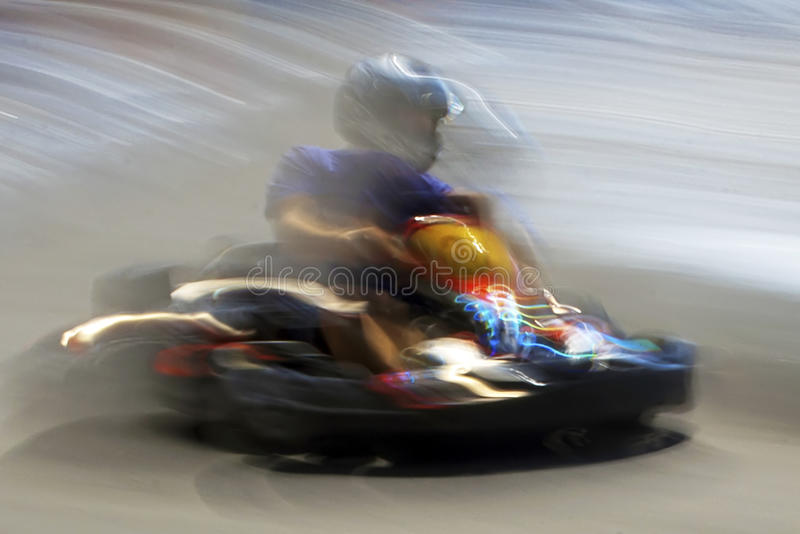 Abstract blurred motion cart man 1. Abstract image with a moving kart man on blurred background stock photography