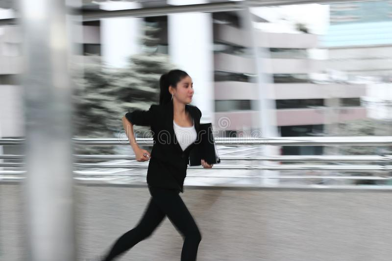 Abstract blurred motion of young Asian business woma running to work stock images