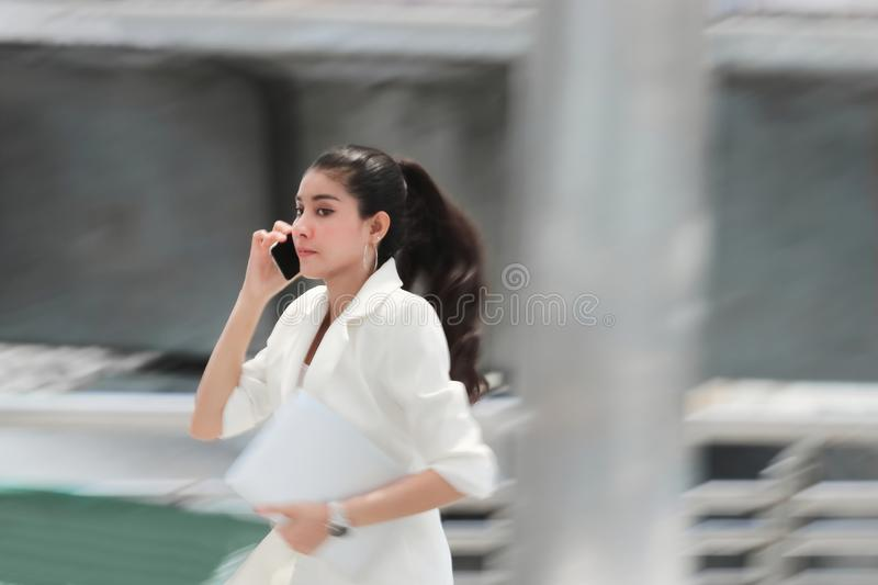 Abstract blurred motion of young Asian business woman running to work stock photos