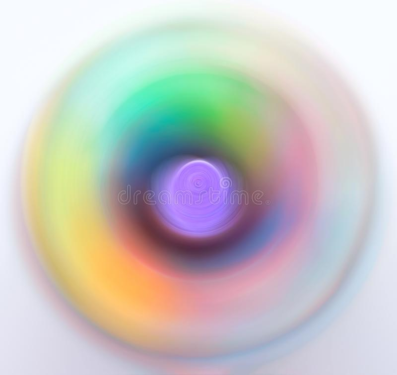 Abstract blurred multicolored whirling concentric circles background spectrum neon vivid pastel colors. Science energy creativity royalty free stock images