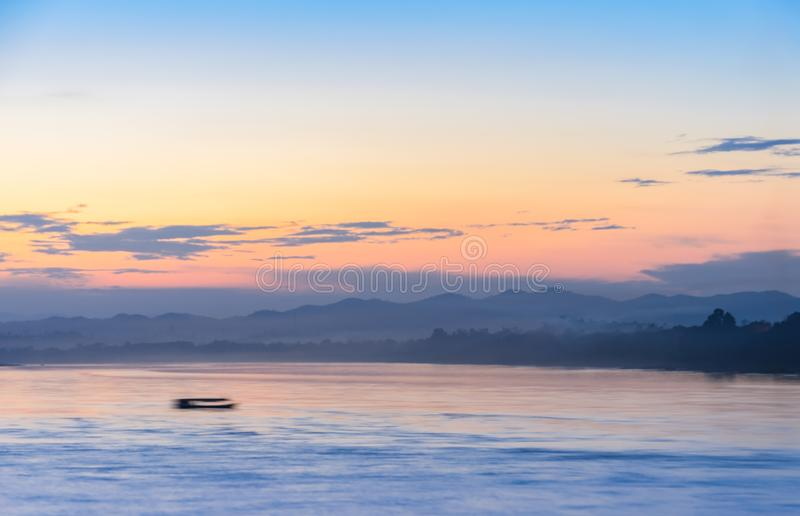 Abstract blurred nature sea and mountain landscape at sunset stock images