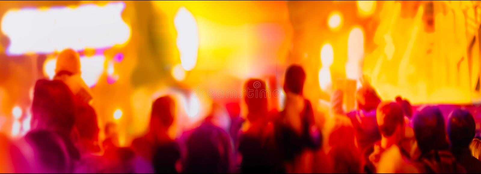 Abstract blurred people at night festival on street stock images