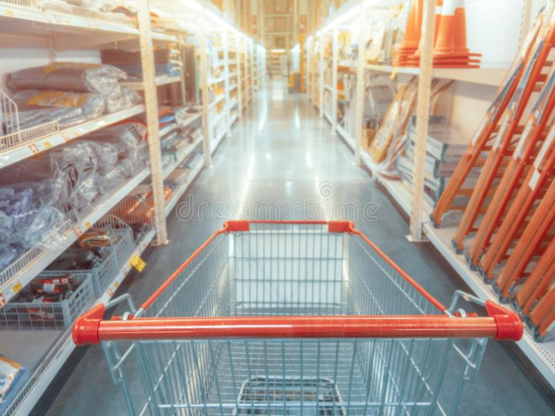 Abstract blurred photo of hardware store with empty shopping car stock image