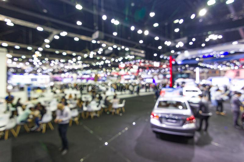 Abstract Blurred, at public event exhibition hall showing cars and new model. New innovation Bangkok Thailand royalty free stock photos