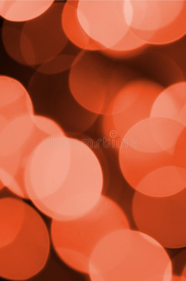 Abstract blurred of red glittering shine bulbs lights background. Blur of Christmas wallpaper decorations concept.  stock photo