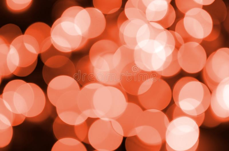 Abstract blurred of red glittering shine bulbs lights background. Blur of Christmas wallpaper decorations concept.  stock image