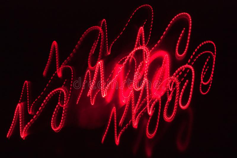 Abstract blurred red light effect on a black background. Long exposure photo of moving camera.  royalty free stock photo