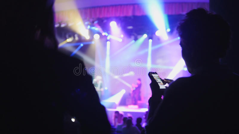 Abstract blurred shadows of people at the concert in the club stock photos