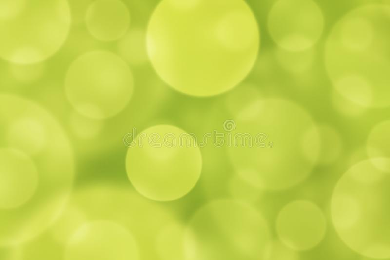Abstract Blurred Shiny Circles in Green and Yellow Background. Abstract image of blurry circles in natural yellow and green background for web background, banner royalty free stock photo