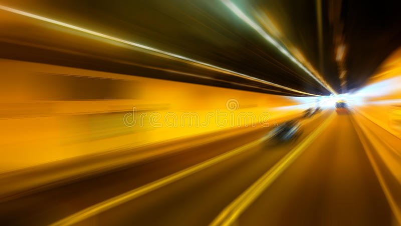 Abstract blurred speed motion in highway road tunnel royalty free stock image