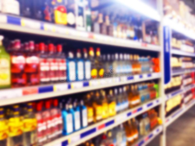 Abstract blurred supermarket store and refrigerators in department store. Interior shopping mall defocused background. Business fo royalty free stock images