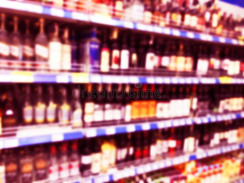 Abstract blurred supermarket store and refrigerators in department store. Interior shopping mall defocused background. Business fo stock photos