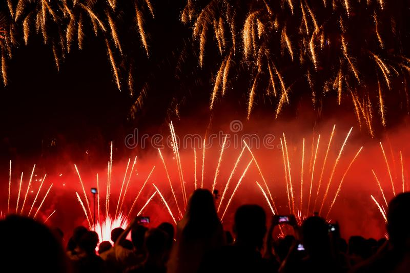 Abstract blurred unrecognizable crowd of young people at concert, show of Fireworks fun of youth, joint leisure stock photography