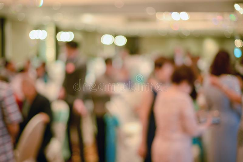 Abstract blurred of wedding ceremony in convention hall stock image