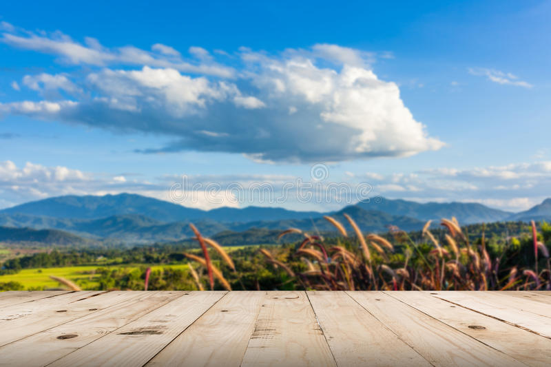Abstract blurred and wood table, beautiful mountains landscape royalty free stock photos