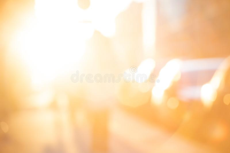 Abstract blurred yellow background with sun light and people with transport. Photo stock images