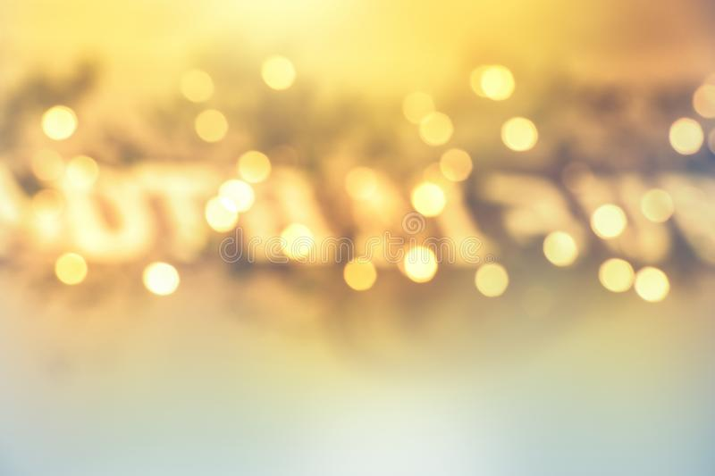 Abstract blurred yellow bokeh lights in festive decoration background royalty free stock images
