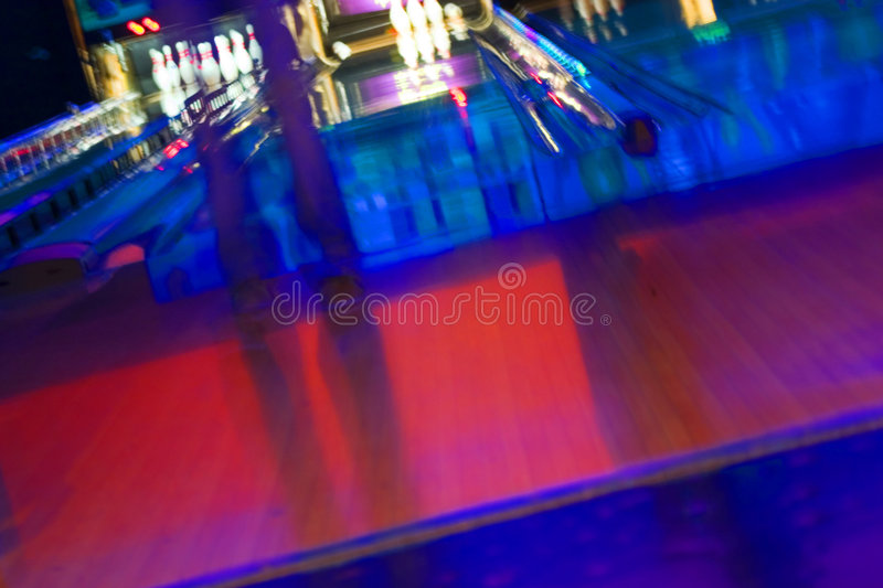 Abstract Blurry Bowling Alley with a girl standing. Abstract Blurry Bowling Alley - Getting ready to bowl, Blurry Girl stock image