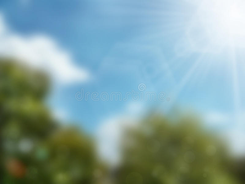 Abstract blurry green background. Abstract blurry tree with bright blue sky and white cloud background stock photos