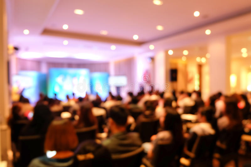 Abstract blurry a lot of people seminar. Abstract blurry a lot of people in the conference or seminar stock photography