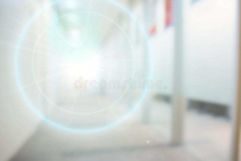 Abstract blurry office background. With strong blue lens flare stock photography